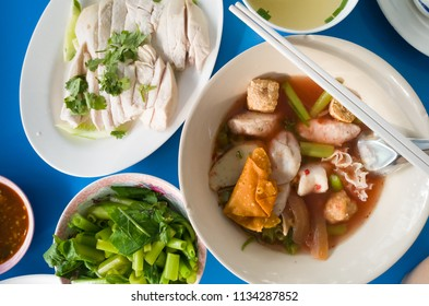 pink seafood noodle with steamed chicken breast sliced