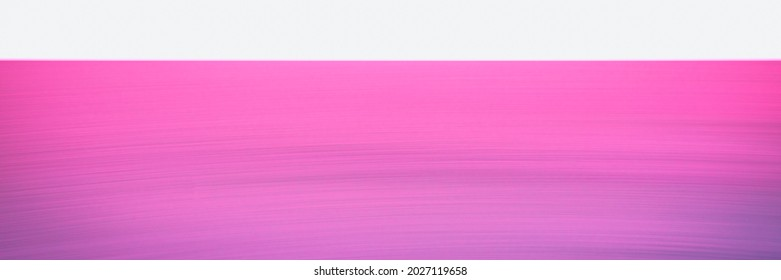 Pink seascape backdrop over the foggy horizon. An empty gradient motion blur backdrop. Cross-processed image of tranquil sunset at Hyannis Harbor in Massachusetts.