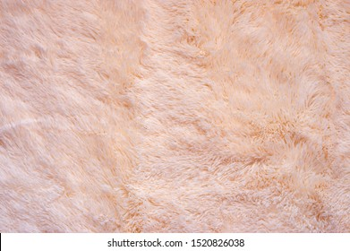 Pink shaggy blanket texture as background. Fluffy fake textile fur. - Shutterstock ID 1520826038