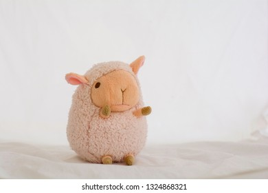 Pink sheep doll on a white background