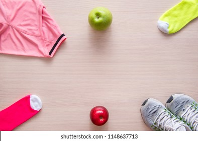 pink shirt, sneakers, yellow socks, green and red apples, sport, flat lay