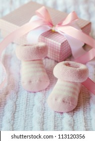 Pink shoes for newly born baby girl. Greeting card, baby shower, birthday card. Vertical with copy space.