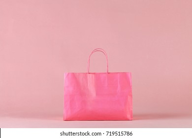 Pink shopping bag. Concept of shopping with space for your text or logo