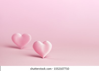 Pink silk heart on a pink background is standing in line.