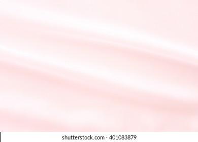 pink silk texture - trend color rose quartz pink pastel tone - close up of elegant textile background