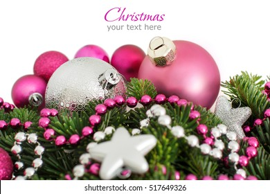 Pink and silver Christmas ornaments border on white background
