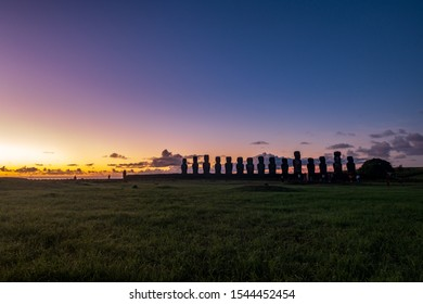 Pink sky and Ahu Tongariki iconic Moai platform at dawn with text space in the sky