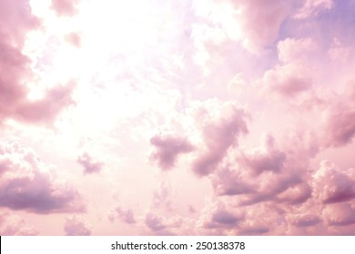 Pink sky background with clouds
