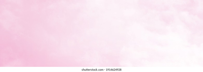 Pink sky background and white clouds background. The sky before a large storm. Pink Sweet dream.