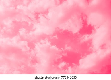 Pink sky background with white clouds.