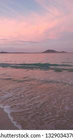 Pink sky at dusk on Kailua Beach, Hawaii