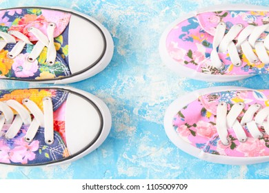 pink sneakers in a flower.Fashion Woman Accessories. blue Pastel Color. Flat lay. Minimal Style.