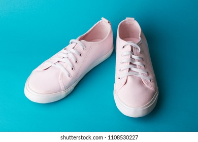 pink sneakers on a blue background