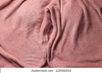 Pink soft fabric shaped as female genital organs, vulva and labia
