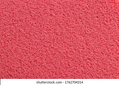 Pink sponge texture. Close-up of a beautiful fleecy pink cosmetic sponge for background. Macro photograph.