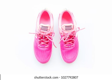 Pink sport shoes on white background