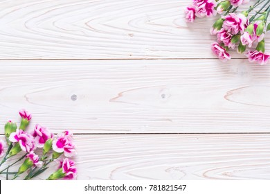pink spring flower on wooden background with copy space