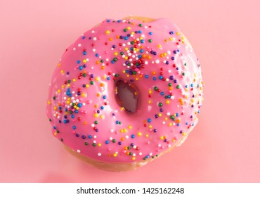 Pink Sprinkle Donuts on a Pink Background