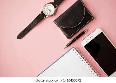 Pink Stationery, white smartphone, pen, wallet, watch calendar notebook Pink background Flatlay