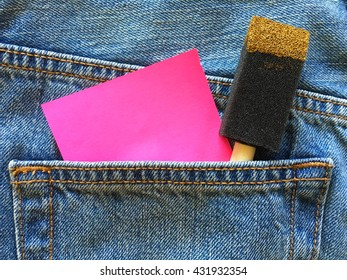 pink sticky note with Foam Paint Brush in the pocket of blue denim jeans