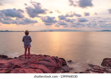 Pink stone (Arkose) and blurred of asian women near Kung Krabaen Wildlife Reserve in the morning in Chantaburi province of Thailand. Select focus