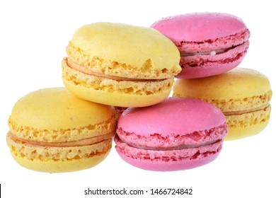 Pink strawberry and peach macarons isolated on white background close up