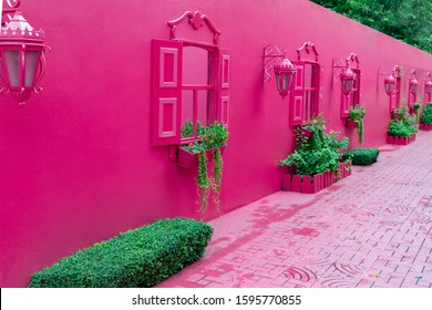 Pink street with green plants, windows, street lams, decorative caribbean entourage in old city victorian style, Puerto plata, Dominican Republic.