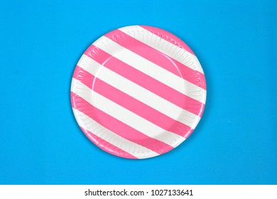 Pink stripe party paper plate on blue background
