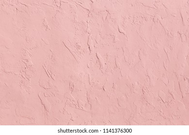 pink structured plaster wall as harmonic background