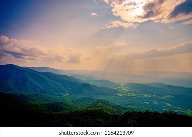 pink sun rays over shenandoah