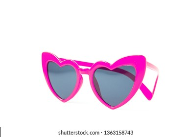 Pink sunglasses heart shape isolated on white background
