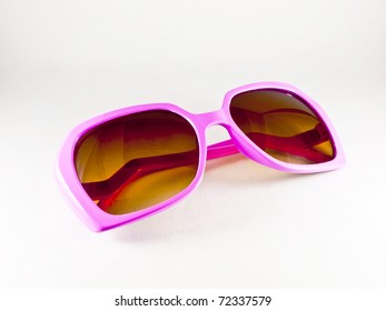 Pink sunglasses isolated on the white background