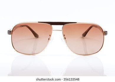 pink sunglasses on white background