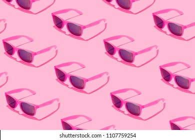 Pink sunglasses pattern on pastel background. Minimal summer concept. Isometric print.