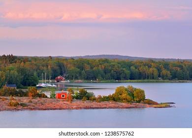 Pink sunset on Aland Islands. Finland