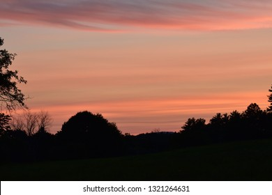 Pink sunset over fiels