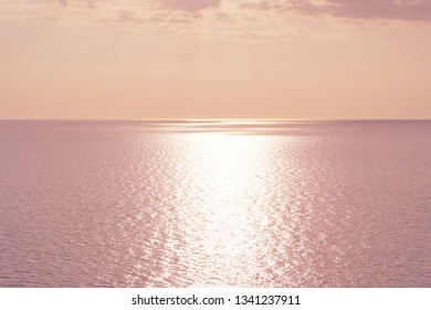 Pink sunset over Mediterranean Sea. Beautiful sunset over calm ocean. Sunrise or sunset over the sea with retro filter effect, summer concept
