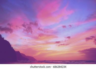 Pink sunset over ocean cliffs