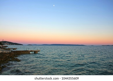 Pink sunset over turquoise sea in Croatia