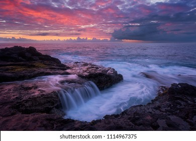 Pink sunset at Pointe des Chateaux in Saint Leu, Reunion Island
