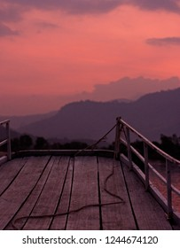 A pink sunset as seen from a boat on a cruise on a Preaek Tuek Chhu River near Kampot in Cambodia