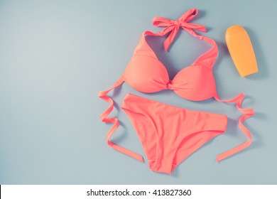 Pink swimsuit on blue background