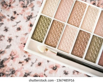 Pink and Tan Eye Shadow Palette on Floral Background