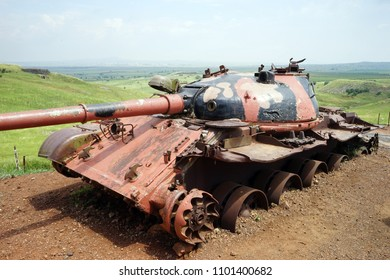 Pink tank of the green foield in Golan Heights in Israel