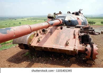 Pink tank of the green foield in Valley of Tears in Golan Heights in Israel