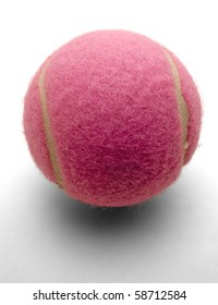 Pink tennis ball on white background