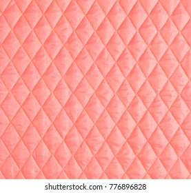 pink textile capitone, background texture high resolution
