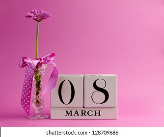 Pink theme, save the date white block calendar for International Women's Day, March 8, decorated with flower, vase and polka dot ribbon.