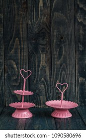 Pink tier serving trays on blue wooden background