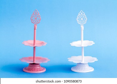 Pink tier serving trays on blue background